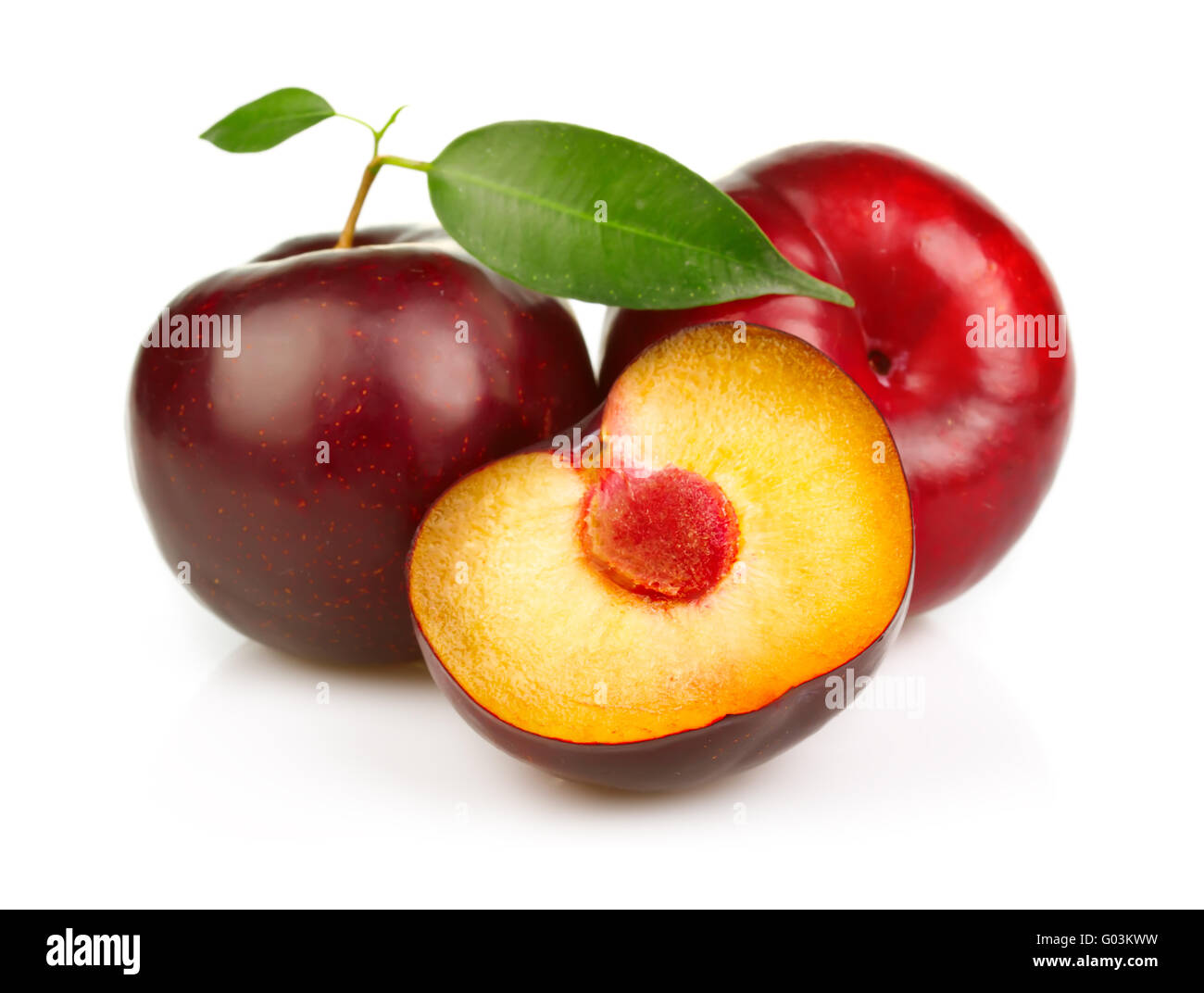 Ripe plums fruit with slices isolated on white - Stock Image
