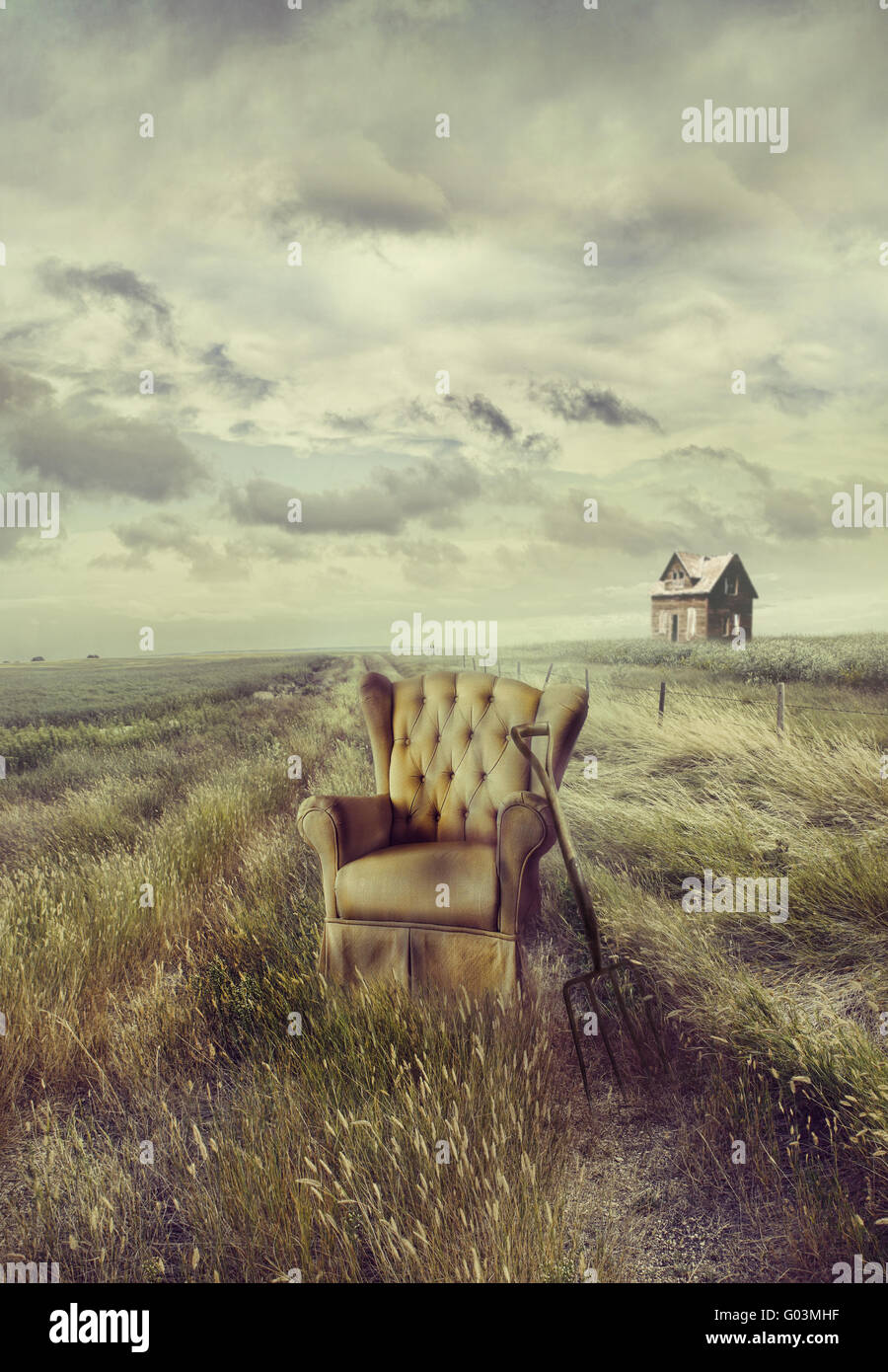 Old Sofa Chair In Tall Grass On Prairie Path Stock Photo