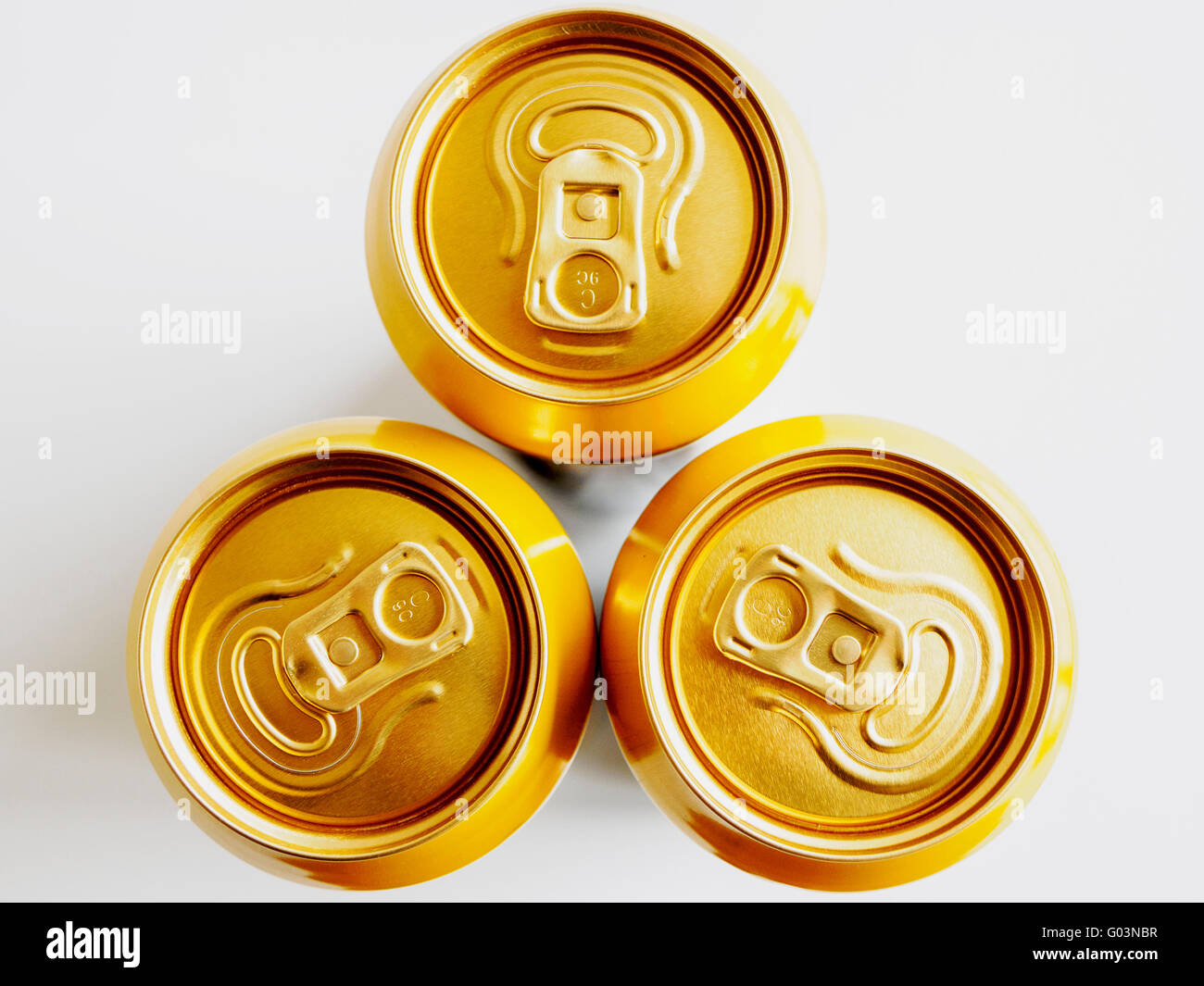 Three ring pull cans seen from above showing the stay-tab opening mechanism - Stock Image