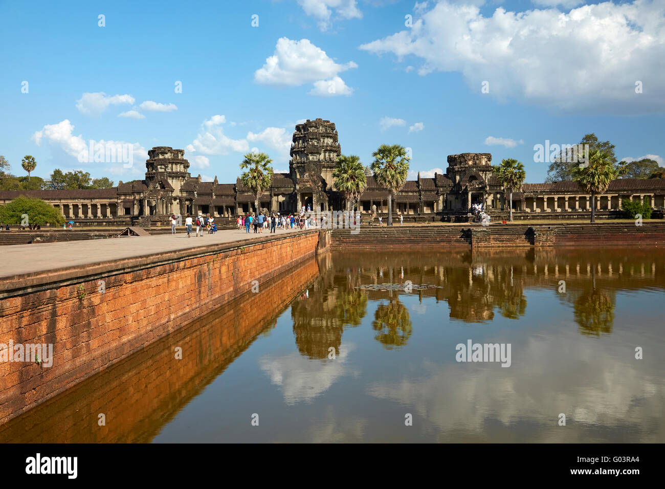 Ancient sandstone causeway crossing the moat to Angkor Wat (12th century), Angkor World Heritage Site, Siem Reap, - Stock Image