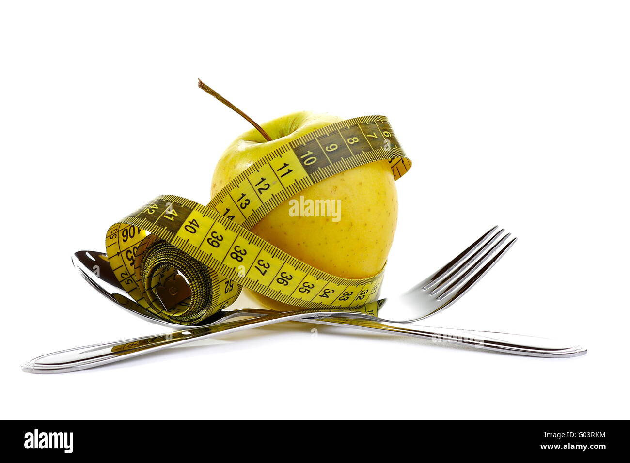 Diet concept. Fresh apple of the measuring tape. - Stock Image