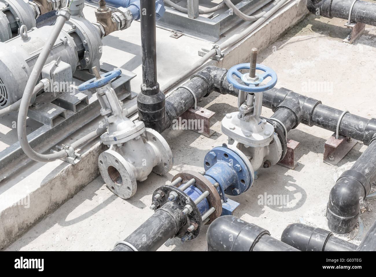 gate valve ,pump ,pipe and equipment waiting for repairing in vintage tone - Stock Image
