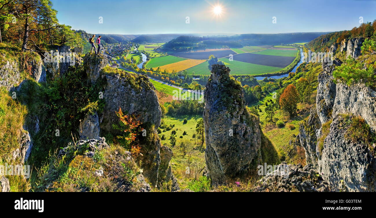 Traveller on a rock, Altmuehl valley, mountain Arn - Stock Image