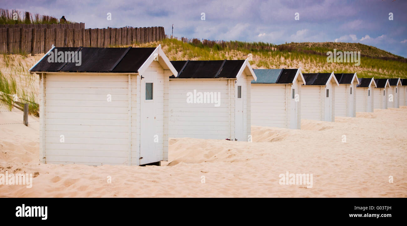 Sandy Beach and huts - Stock Image