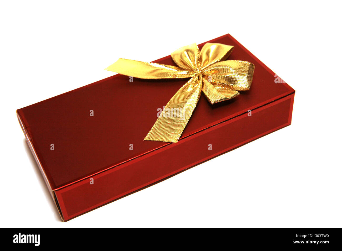 Dark red gift box with golden ribbon isolated on the white - Stock Image