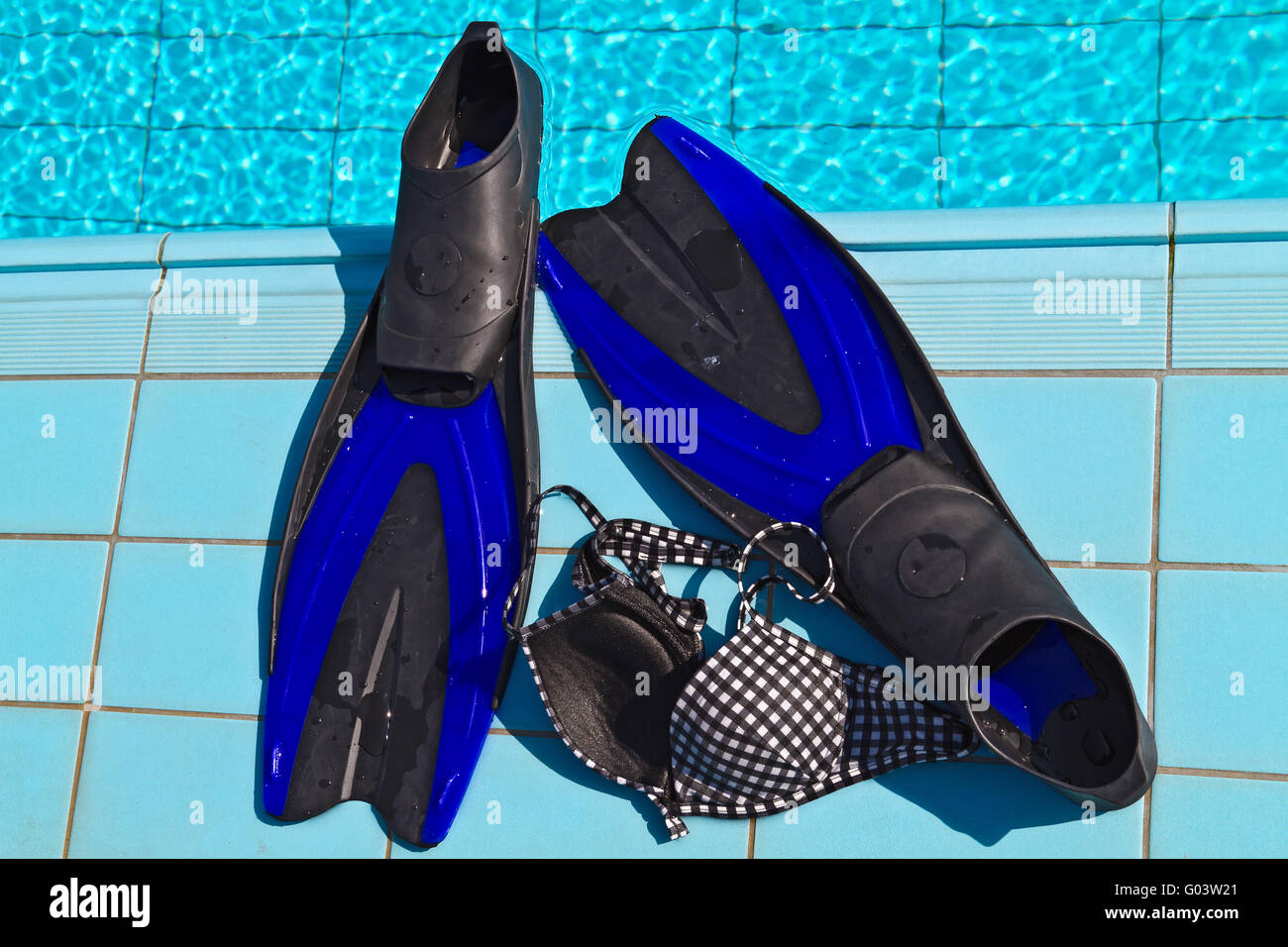 Flippers with bikini top - Stock Image