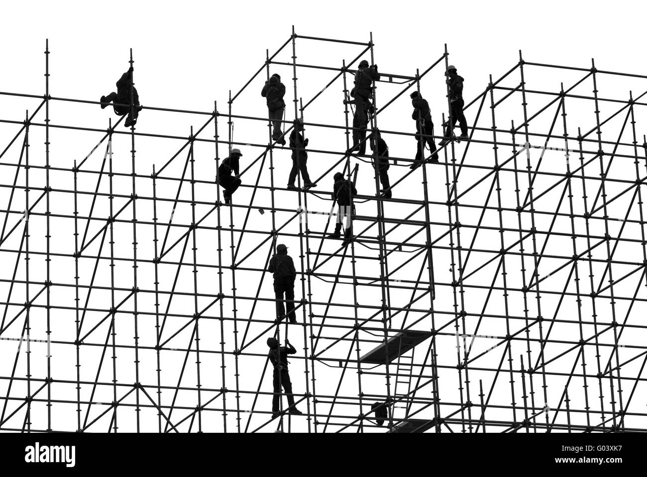 workers on a high-rise scaffolding, Hong Kong - Stock Image