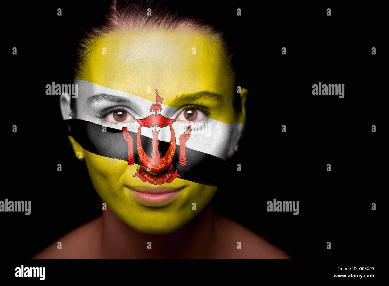 Portrait of a woman with the flag of the Brunei - Stock Image