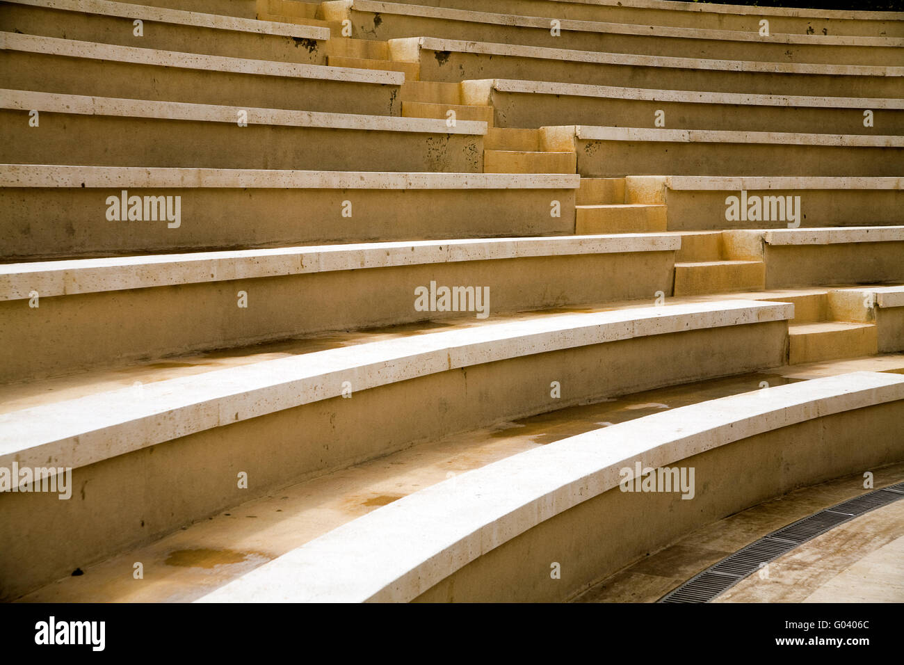 ancient stages and seats from a yellow granit ston - Stock Image
