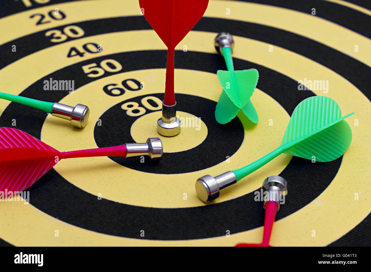 the magnetic needle darts in the center of the tar - Stock Image
