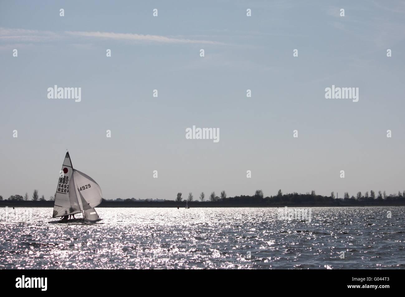 Sailboat sailing on a lake - Stock Image