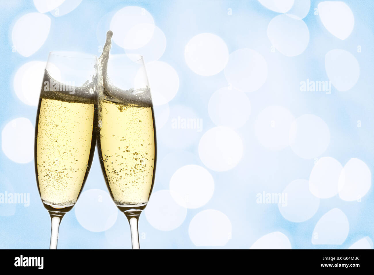 two glasses of sparkling wine with abstract lights Stock Photo