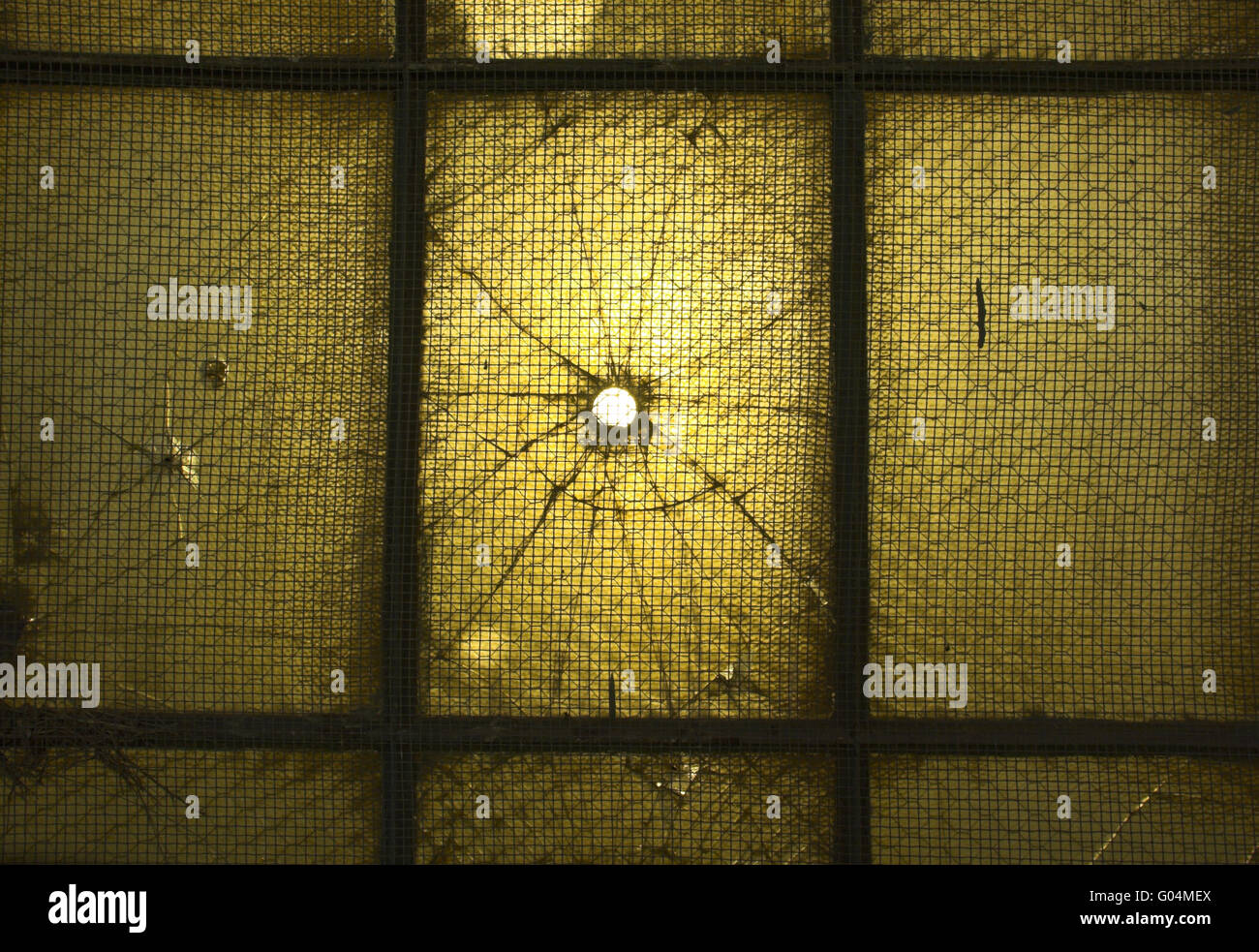 Hole in the window with light coming through it - Stock Image