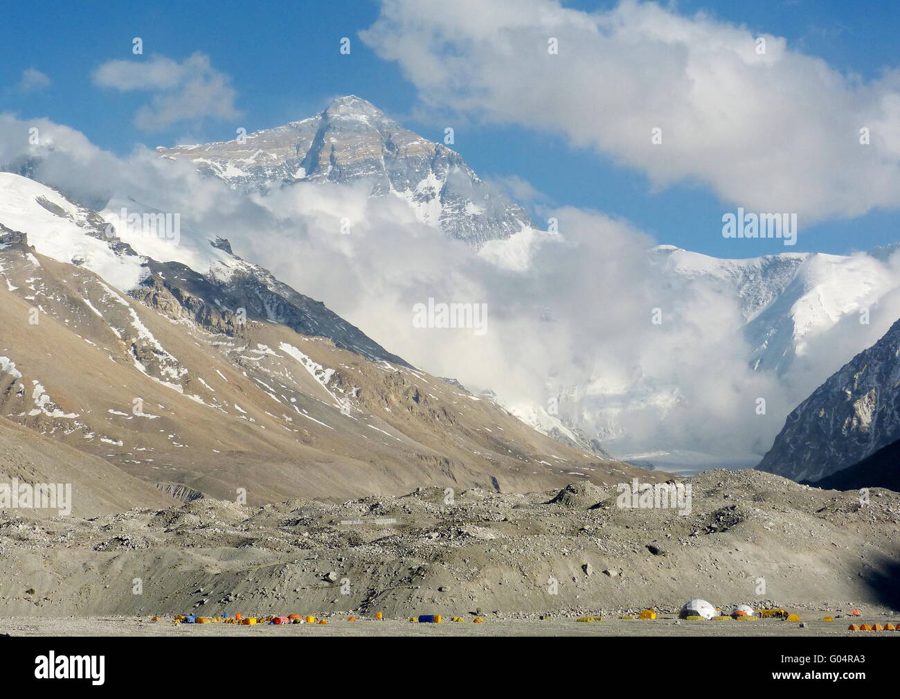 Mount Everest as seen from Everest Base Camp from Tibet side.  The tents in the foreground are of the climbers of - Stock Image