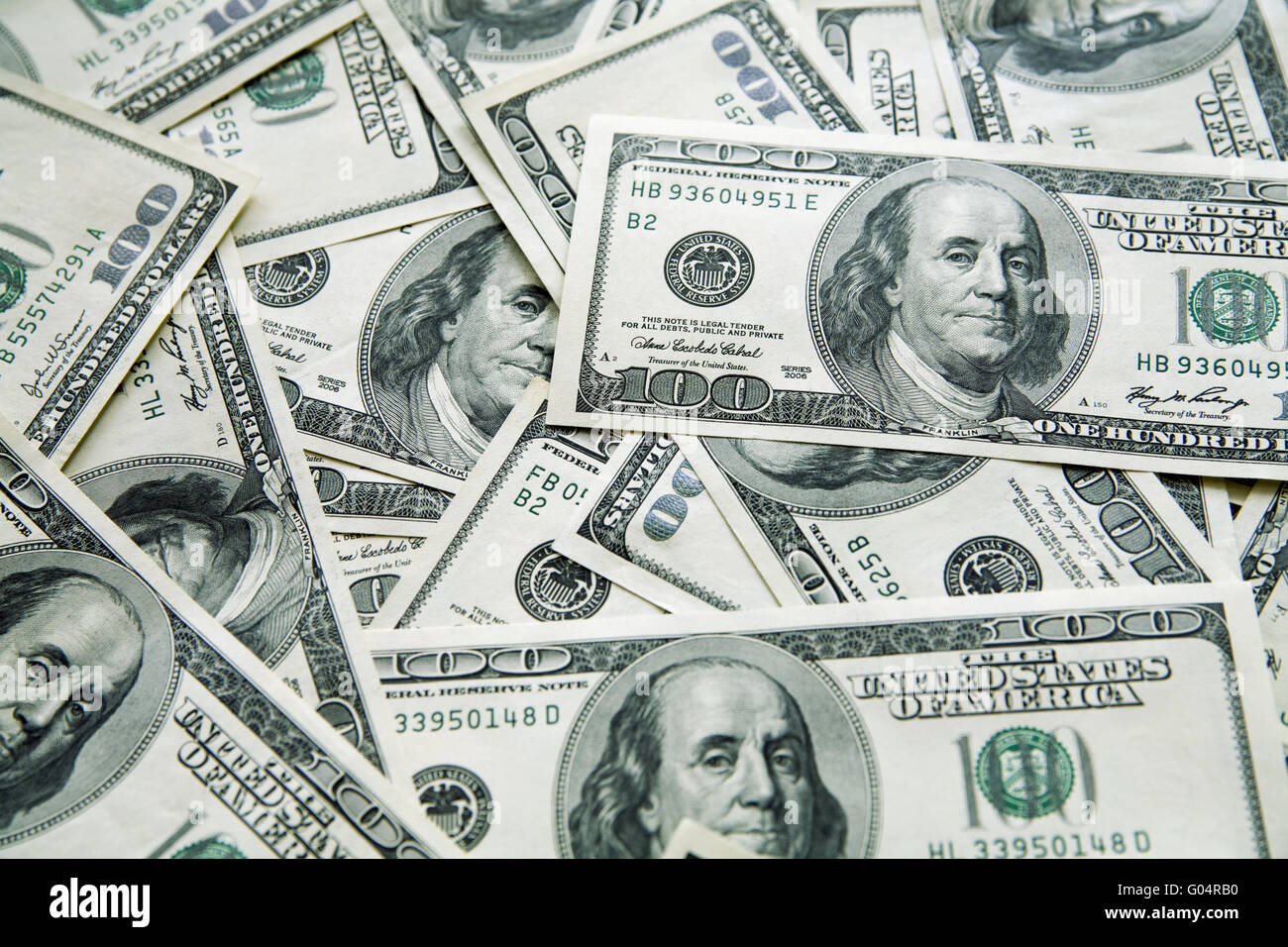 background from chaotically lyings one hundred greenbacks - Stock Image