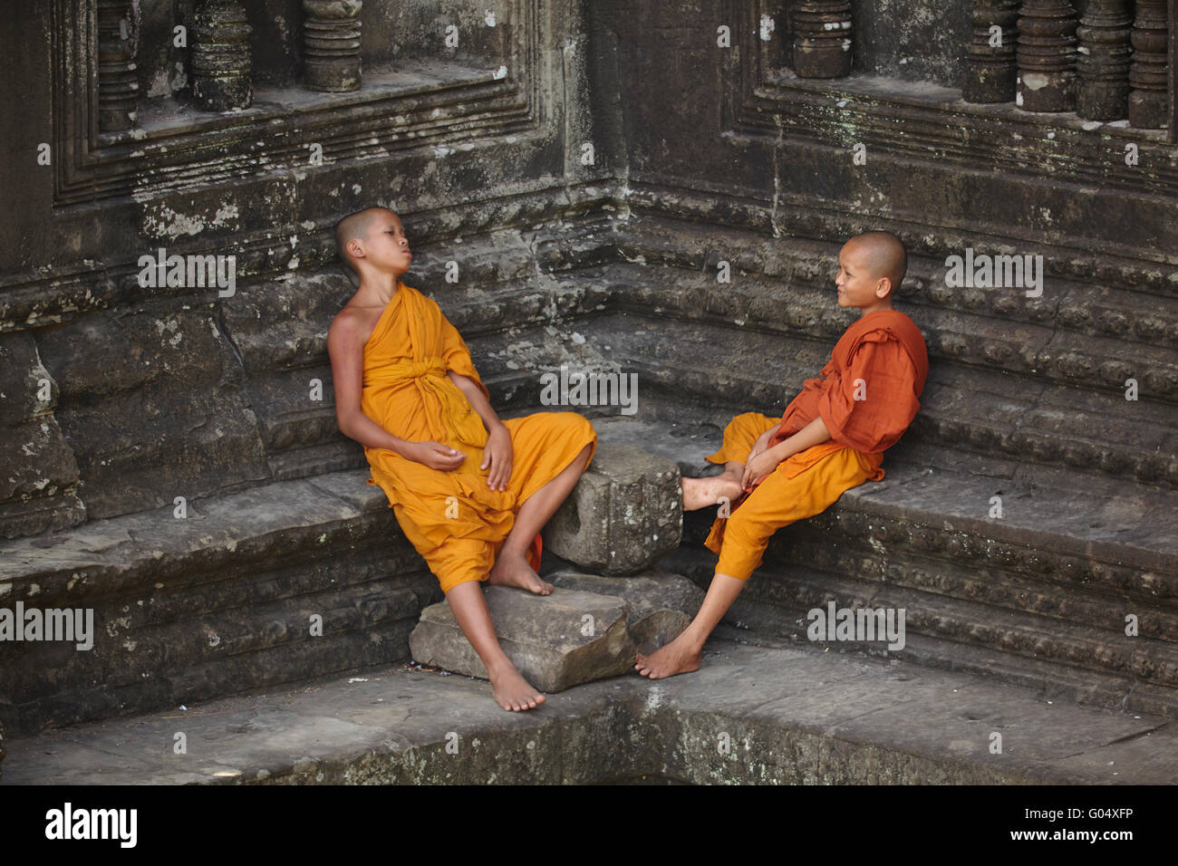 Young Buddhist monks at Angkor Wat (12th century Khmer temple), Angkor World Heritage Site, Siem Reap, Cambodia - Stock Image