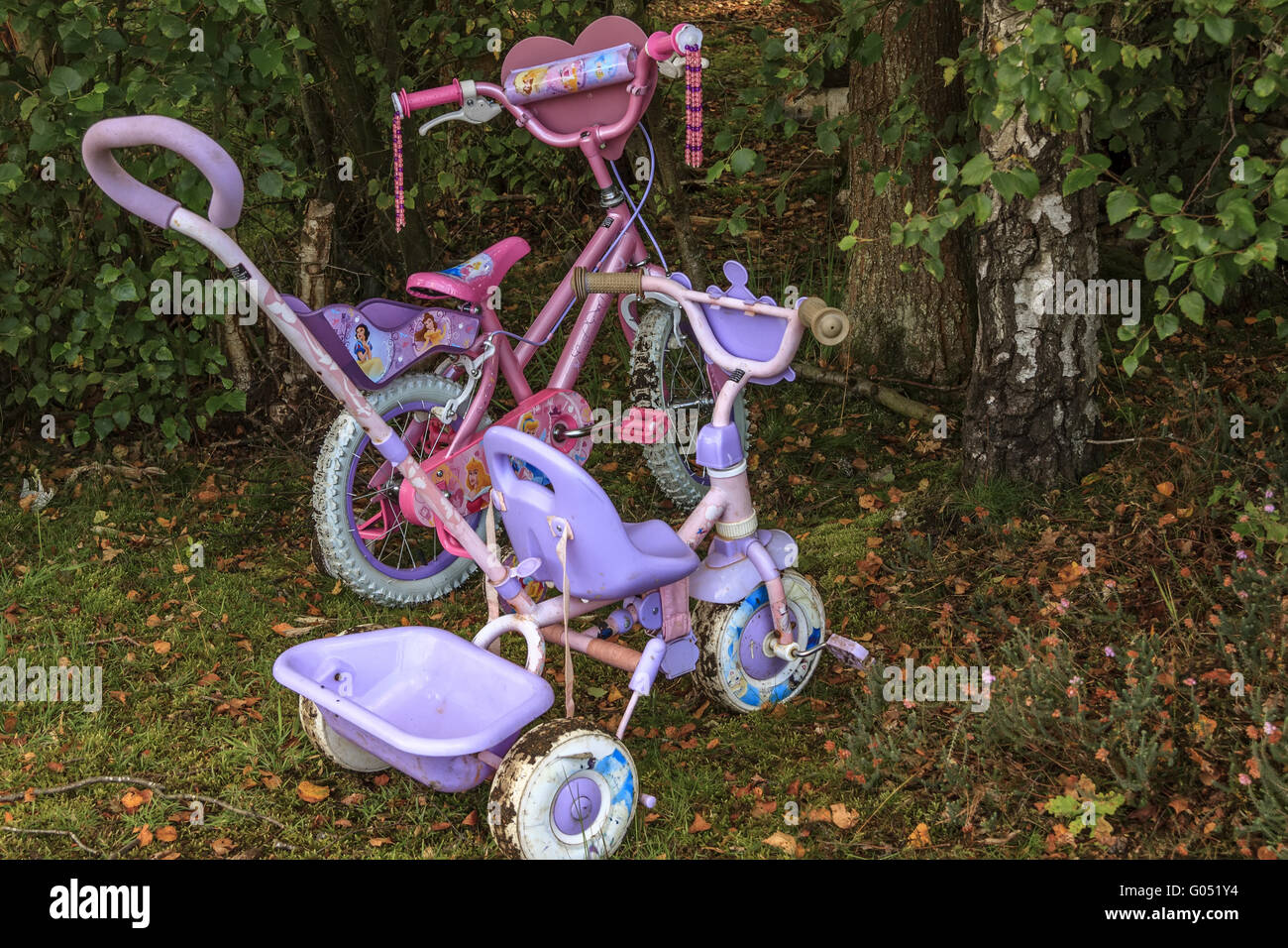 Childrens Toys Abandoned In The Woods Berkshire UK - Stock Image