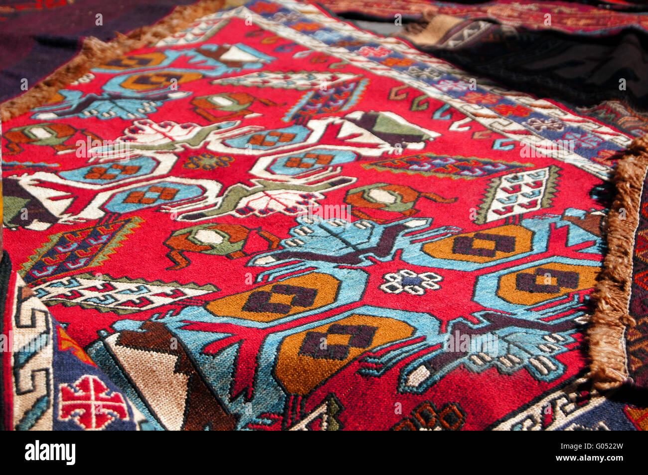 Old carpets in the street market in Tbilisi Old town, Republic of Georgia - Stock Image
