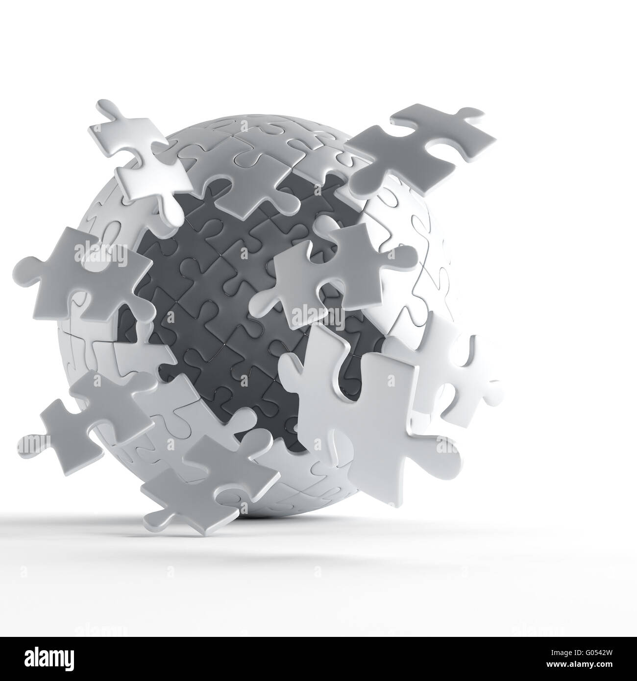 exploding ball of gray puzzle pieces on white back - Stock Image