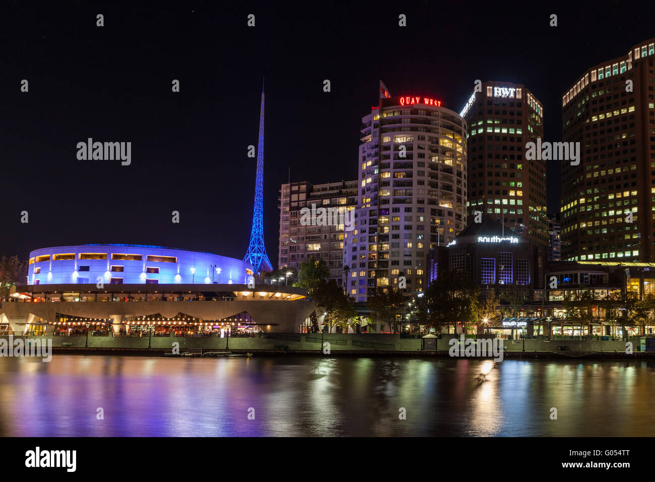 Melbourne CBD - APR 16 2016: Nightscape over Yarra river with Melbourne Arts Centre tower lit in bright blue color. - Stock Image