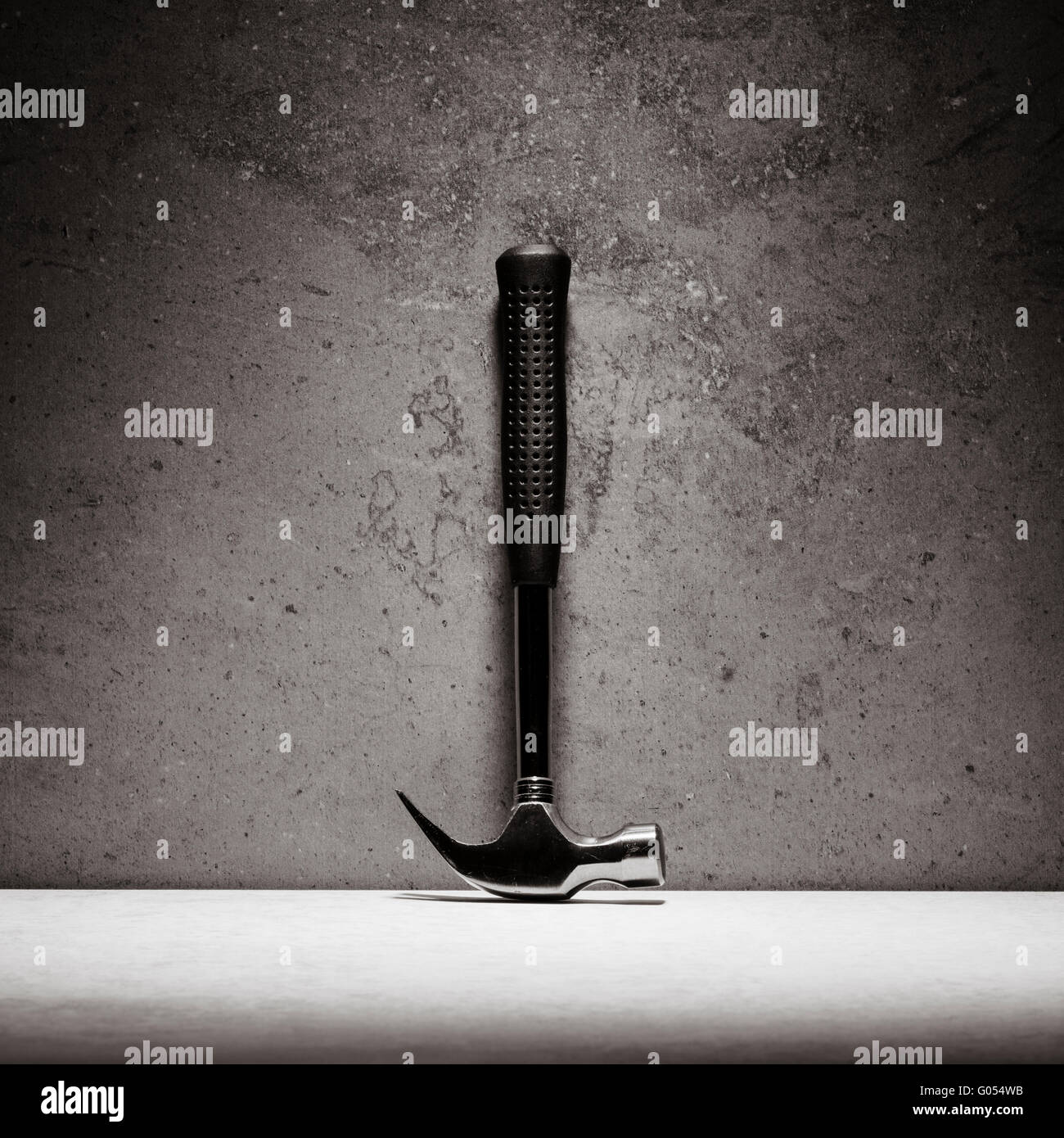 Hammer and stone wall. Still life of work tool. Concept of diy and repair. - Stock Image