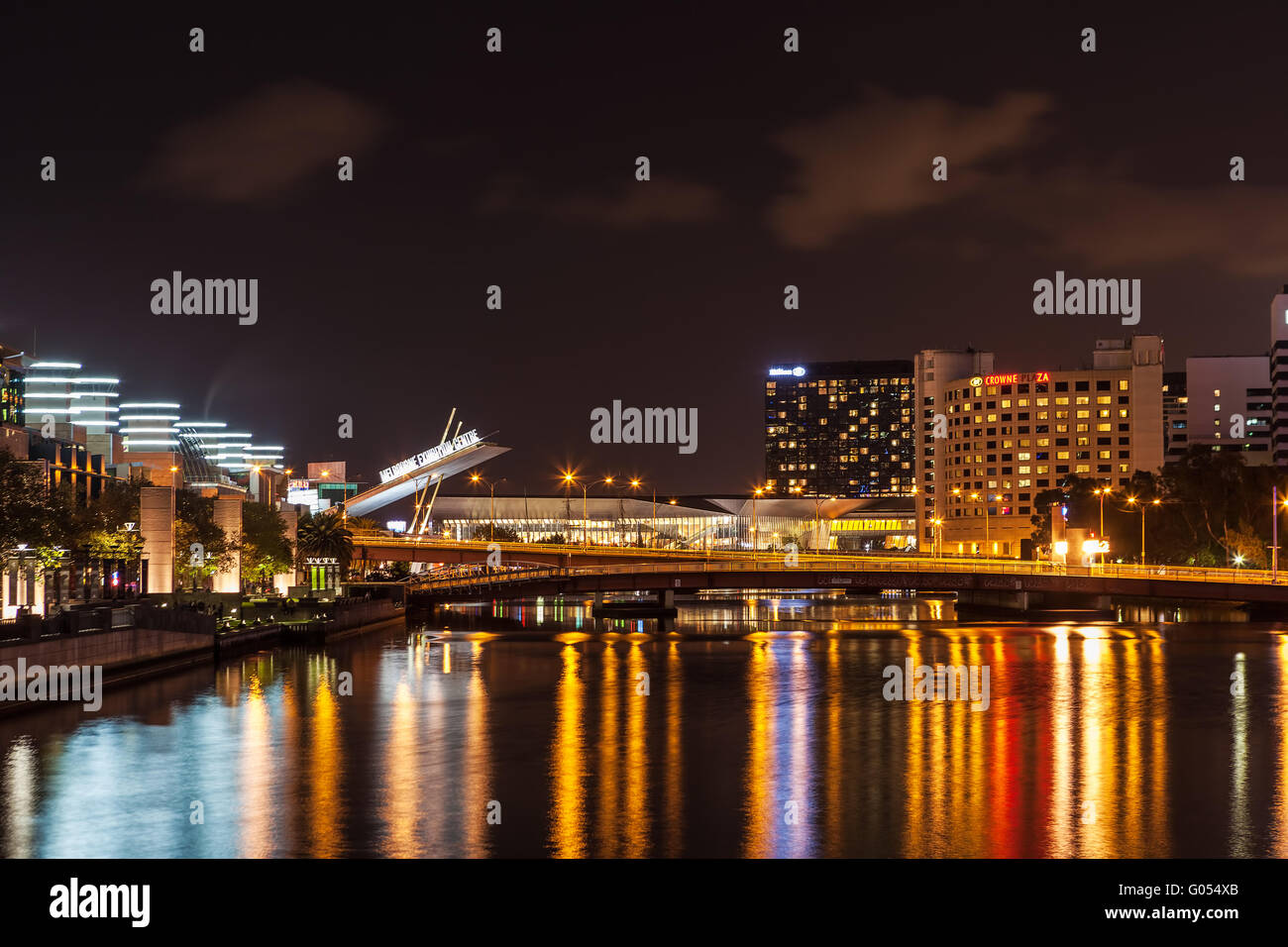 Melbourne CBD - APR 16 2016: Nightscape with Melbourne Exibition Centre sign and light reflections in Yarra River - Stock Image