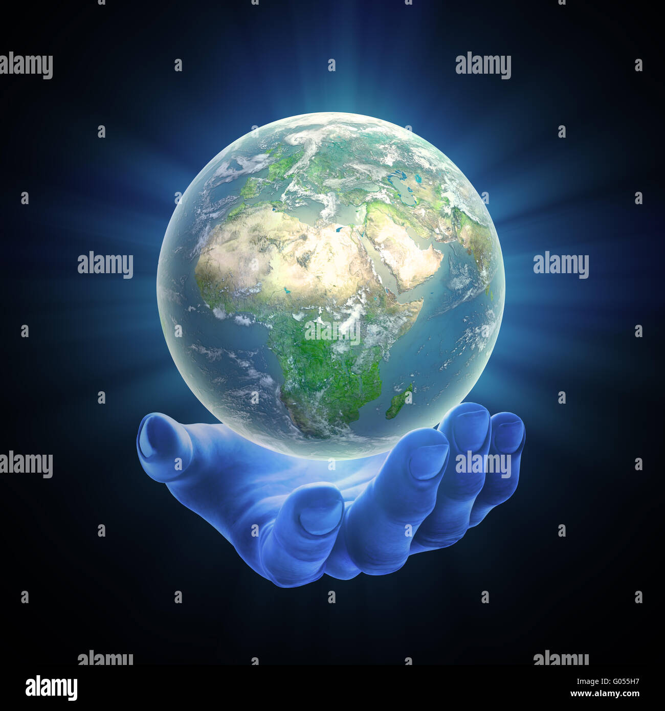 illustrated hand holding a glowing Earh globe - Stock Image