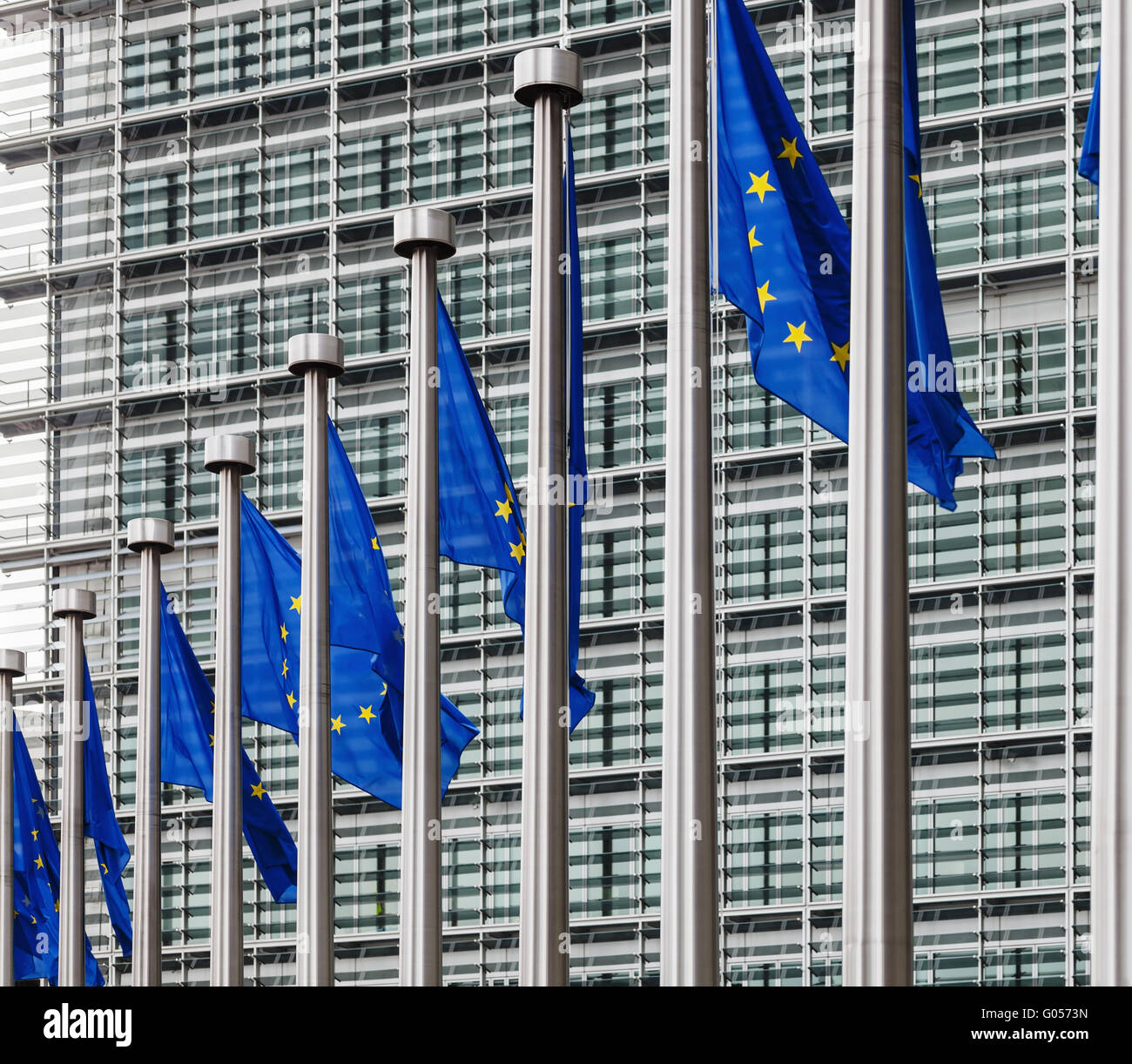 EU flags in front of berlaymont building - Stock Image