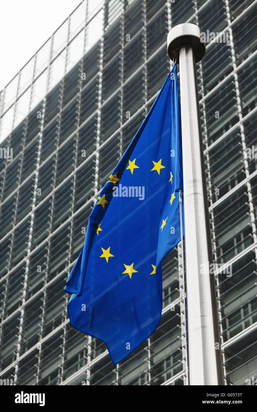 EU flag in front of berlaymont building - Stock Image