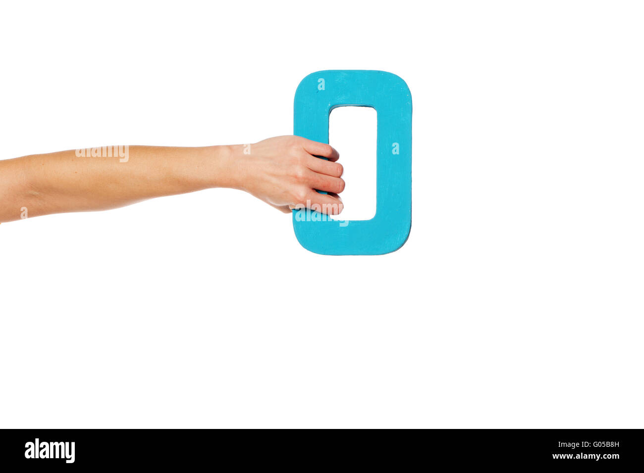 hand holding up the number zero from the left - Stock Image