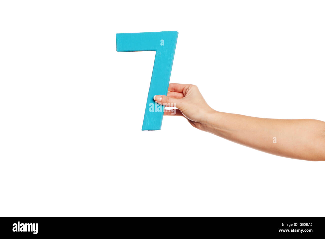 hand holding up the number seven from the right - Stock Image