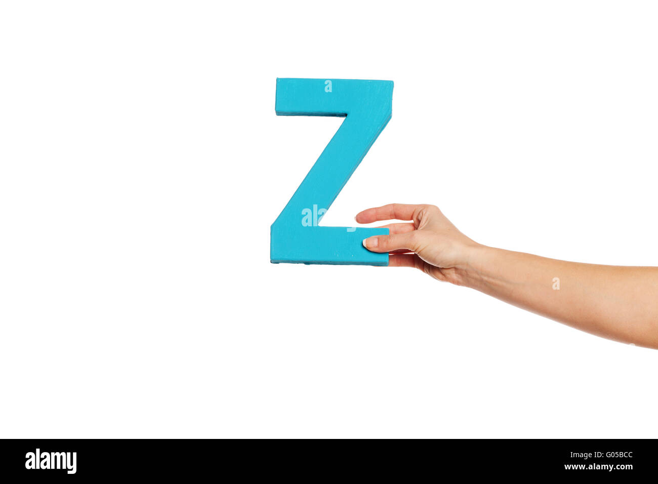 hand holding up the letter Z from the right - Stock Image