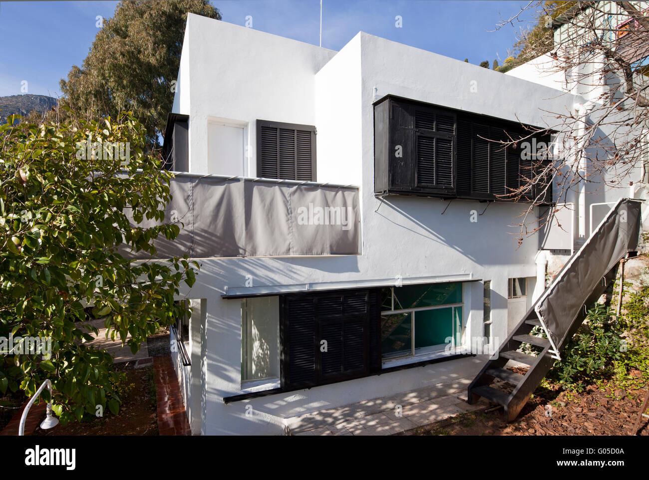 Exterior facade with stairway to garden. Eileen Gray's house E-1027,  Roquebrune-Cap-Martin, France. Architect: Eileen Gray, 1929.
