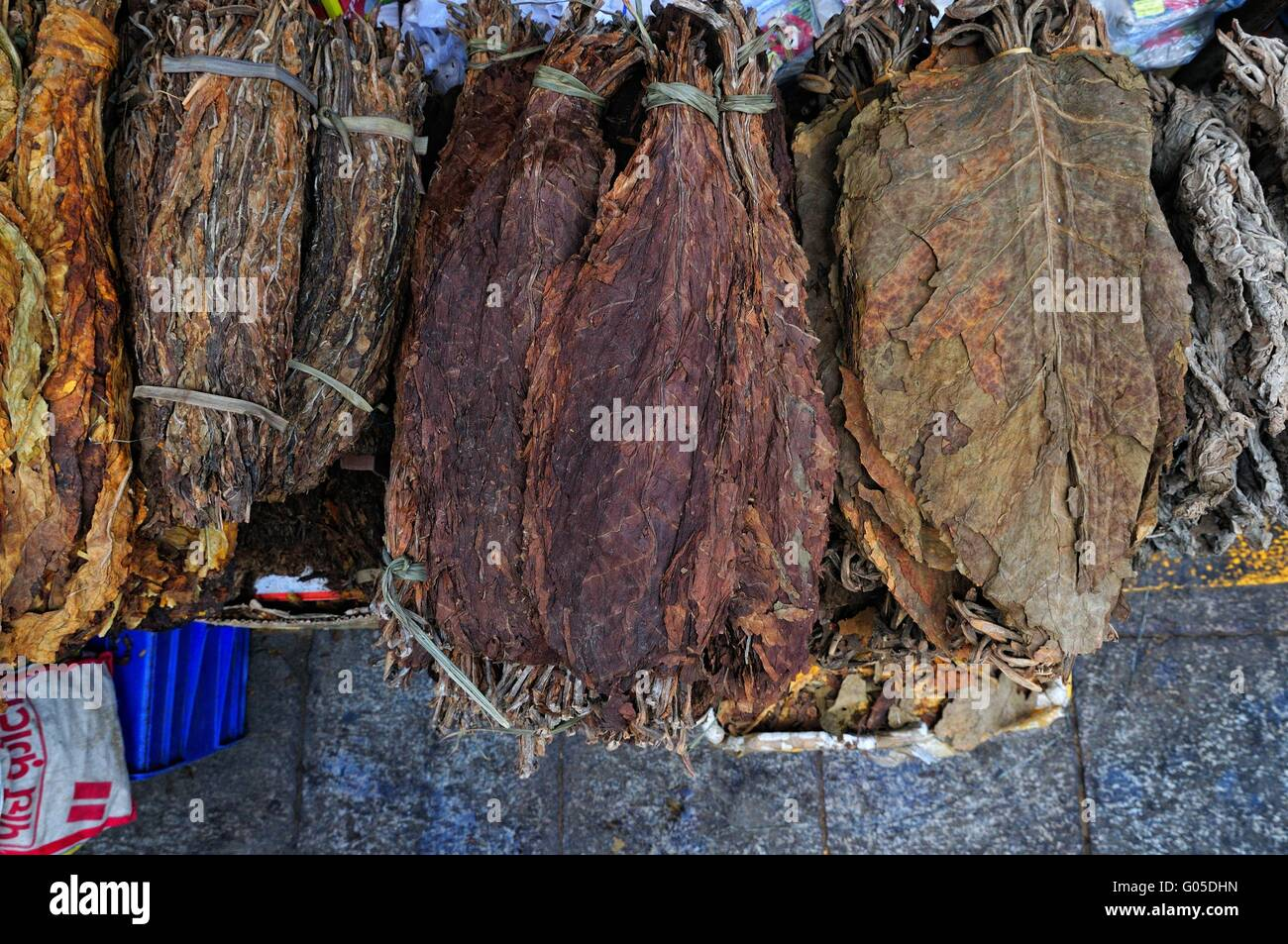 various dry tobacco leaves bound market Lhasa - Stock Image