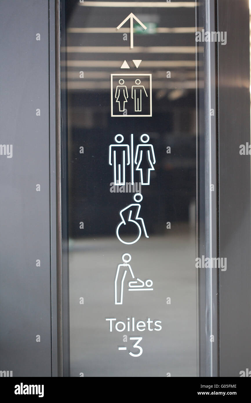 Wayfinding direction sign - Toilets, Lifts, Baby Changing & Accessible Toilets Stock Photo
