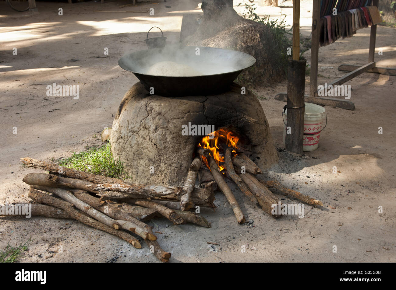 Oven with bowl to cook palm sap into  palm sugar Stock Photo