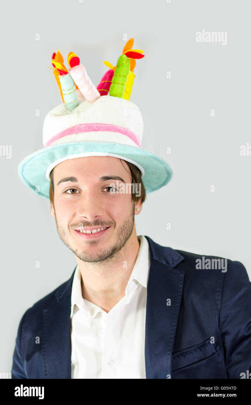 Smiling Cute Guy With Funny Birthday Cake Hat