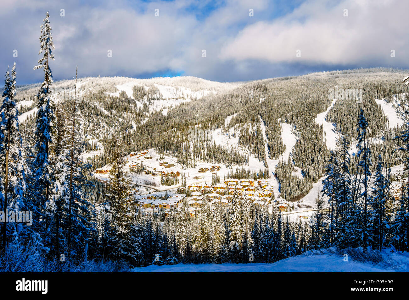 The winter sport village of Sun Peaks in the Shuswap Highlands of British Columbia on a nice winter day - Stock Image