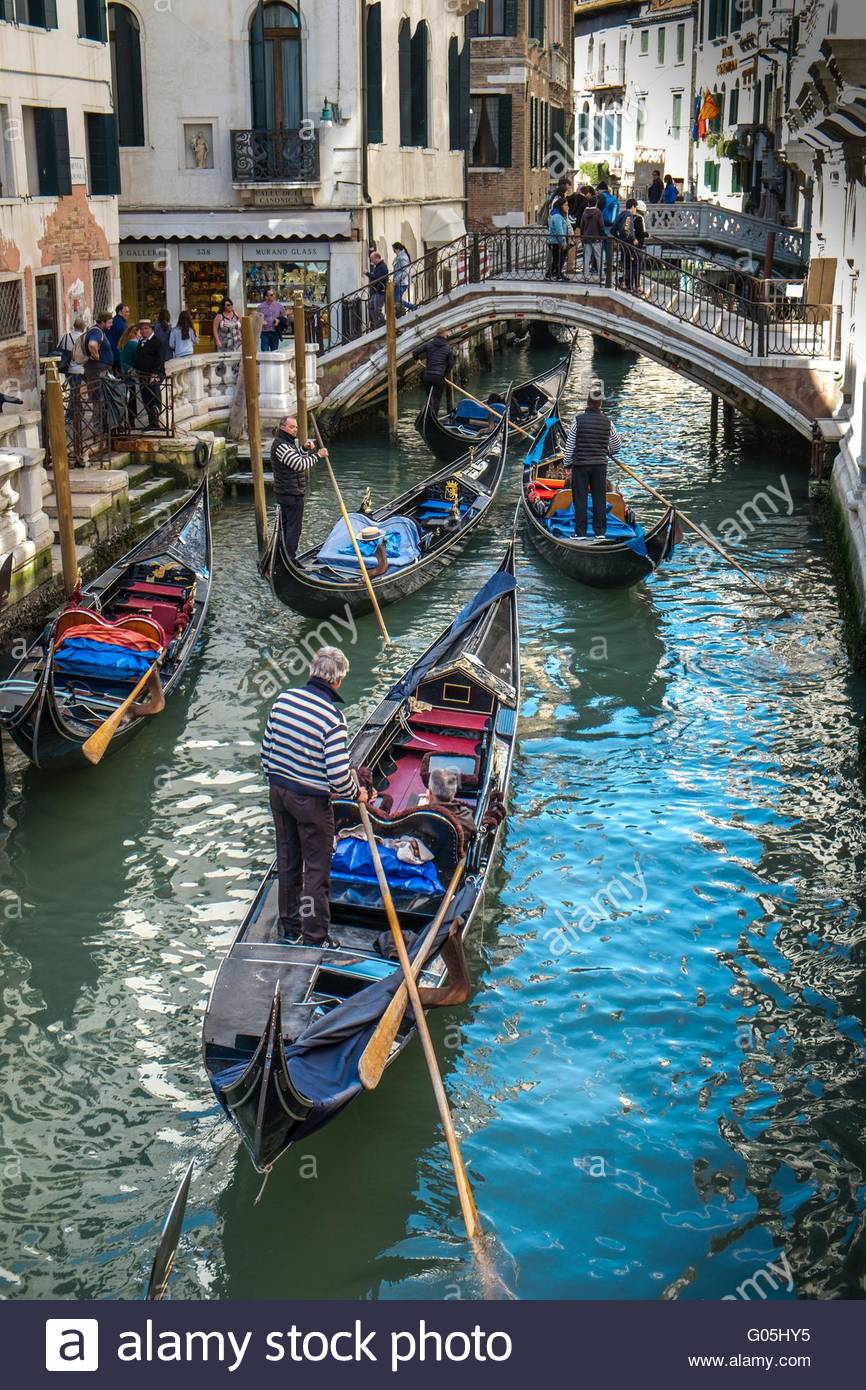 Gondolas with tourist passengers negotiating the canals of Venice, Italy, April - Stock Image
