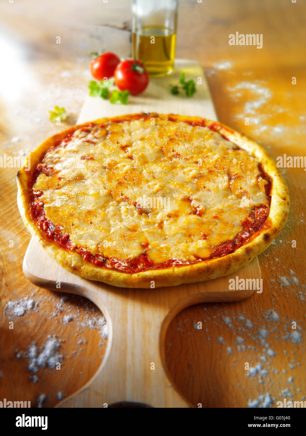 Cooked whole cheese and tomato Margherita pizza - Stock Image