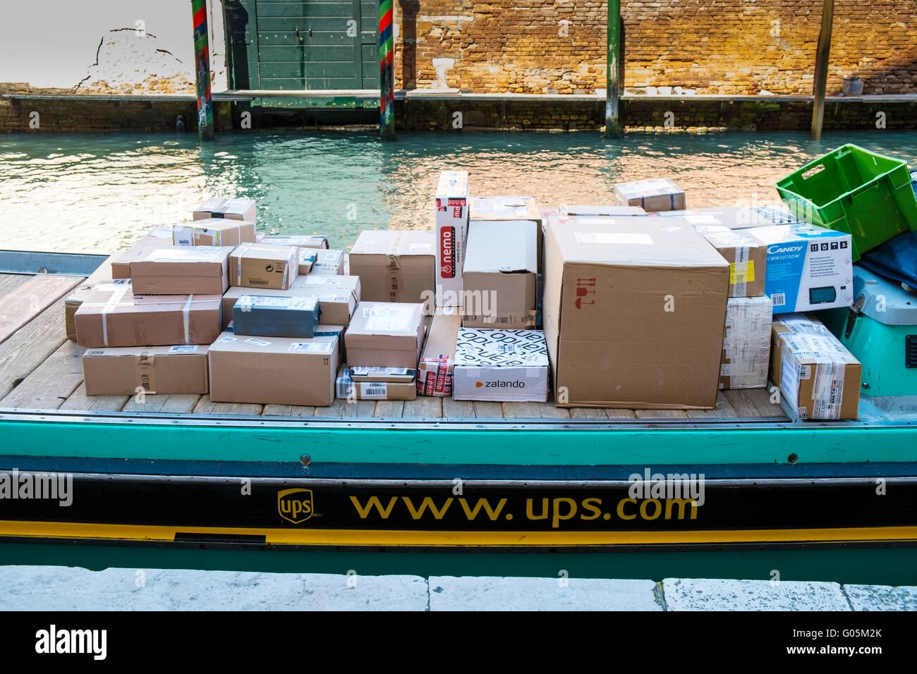 Parcels awaiting delivery on a UPS delivery boat, Venice, Italy, April - Stock Image
