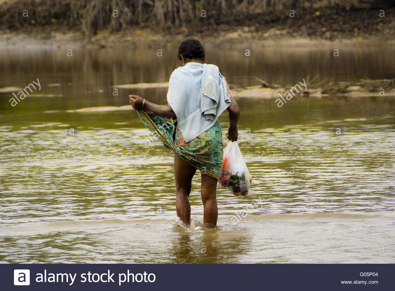 Woman on the posthouse way by the mangroves - Stock Image