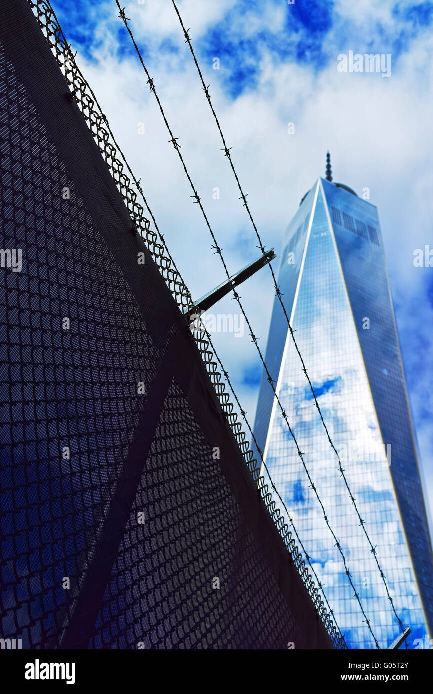 NEW YORK, USA - APRIL 24, 2015: One World Trade Center and barbed wire in Lower Manhattan, New York City, USA. It - Stock Image