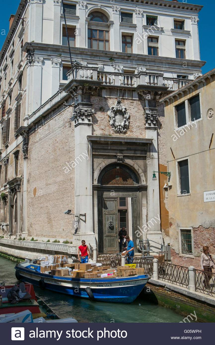 Delivery barge unloading parcels to hotoel Venice, Italy, April - Stock Image