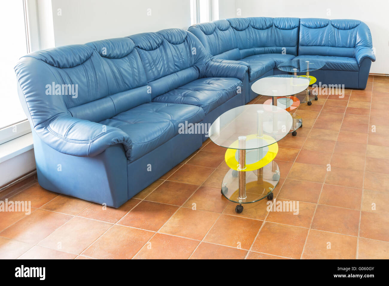 Astounding Empty Waiting Room With A Big Blue Sofa And Two Small Tables Uwap Interior Chair Design Uwaporg