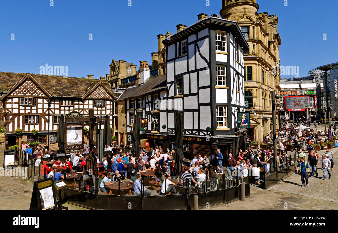 The Old Wellington Inn and Sinclairs Oyster Bar, popularly known as 'The Shambles' in Exchange Square Manchester, Stock Photo