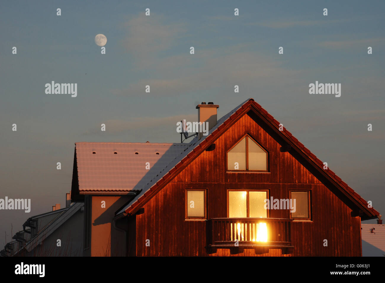 Wintersun reflecting in the window of a house - Stock Image