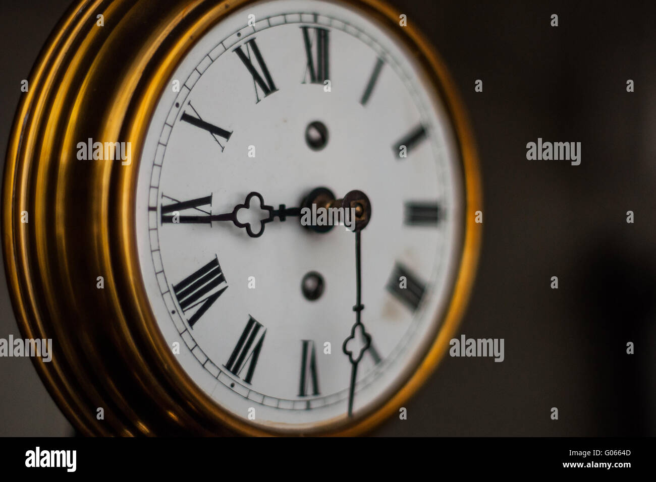 antique clock with roman numerals - Stock Image