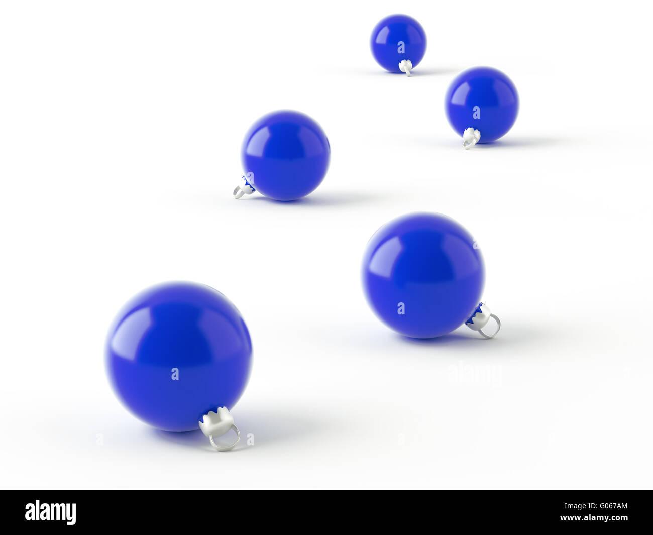 row of blue christmas balls on white background - Stock Image