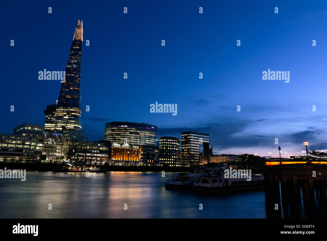 Sunset on the London skyline showing The Shard and Thames - Stock Image
